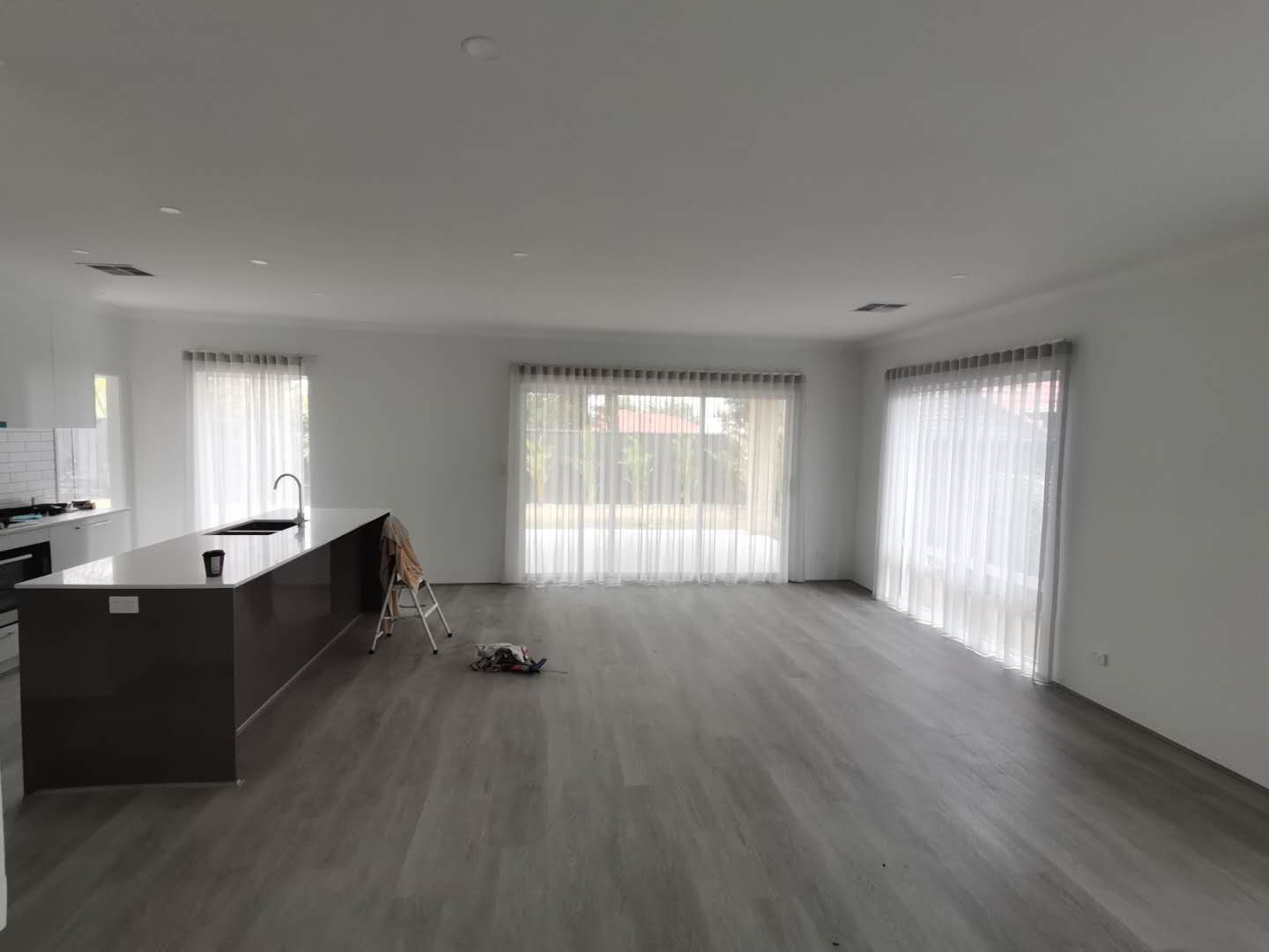White sheer curtains for room's windows