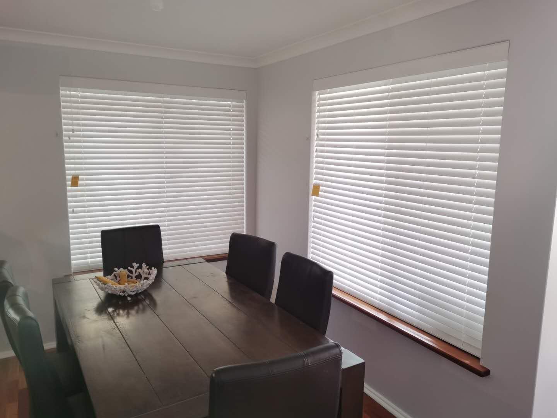 Timber venetian blinds for windows.