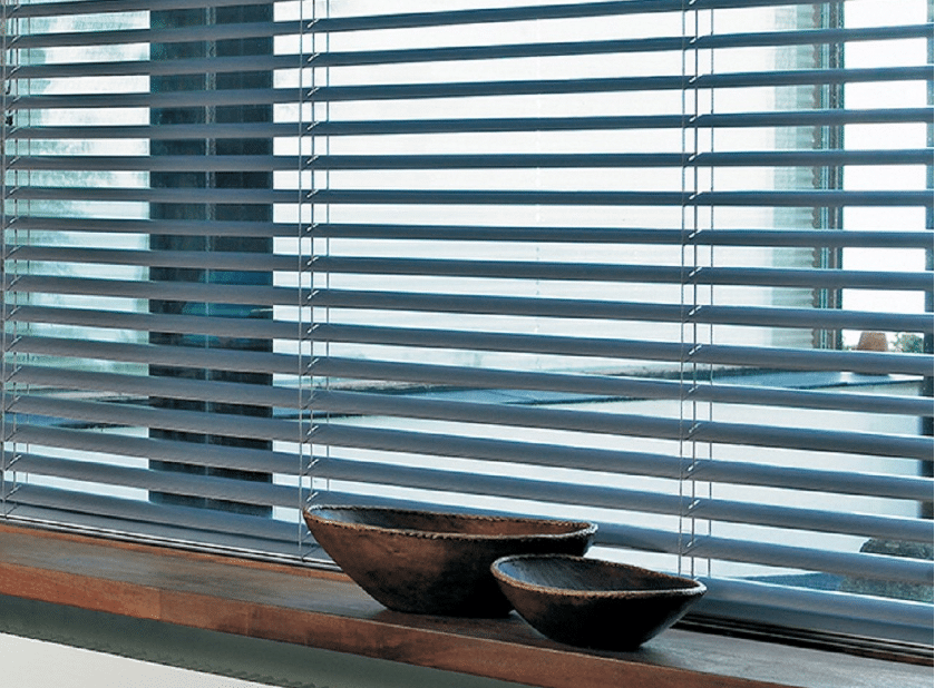 Beautiful bowls placed in front of Aluminium blinds